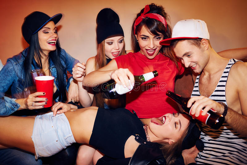 sexual-drinking-games-student-party-group-friends-crashing-noisy-students-house-pour-beer-bottles-right-mouth-79044140.jpg