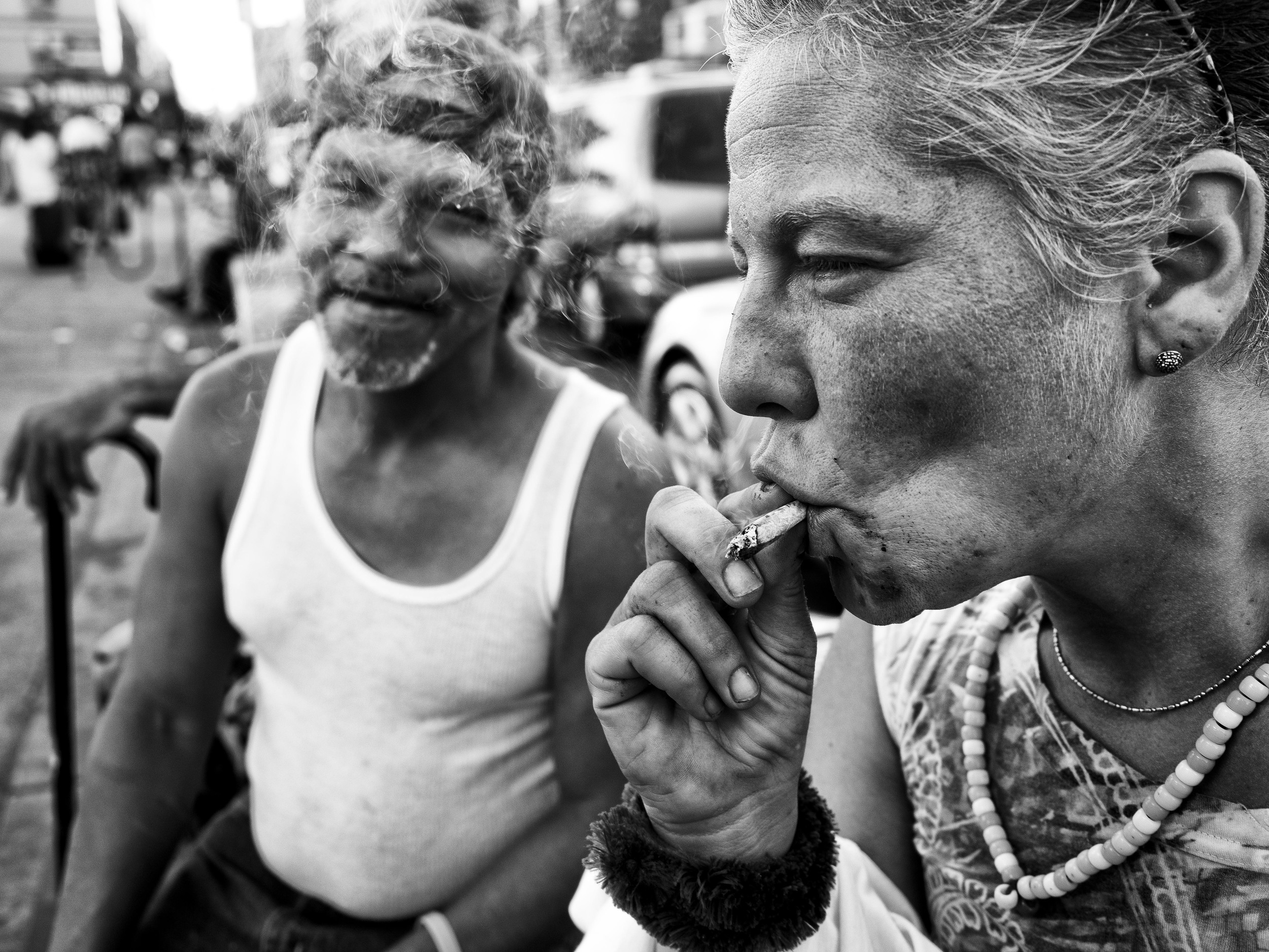 A woman smokes synthetic marijuana -- also know as K2 -- near 125th and Lexington Avenue on Tuesday, September 15, 2015 in New York, N.Y.