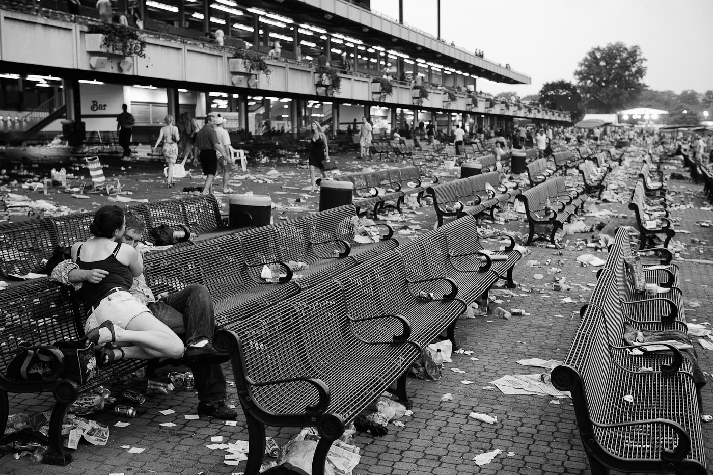A couple sits in Belmont Park after the 140th running of the Belmont Stakes in Elmont, NY.