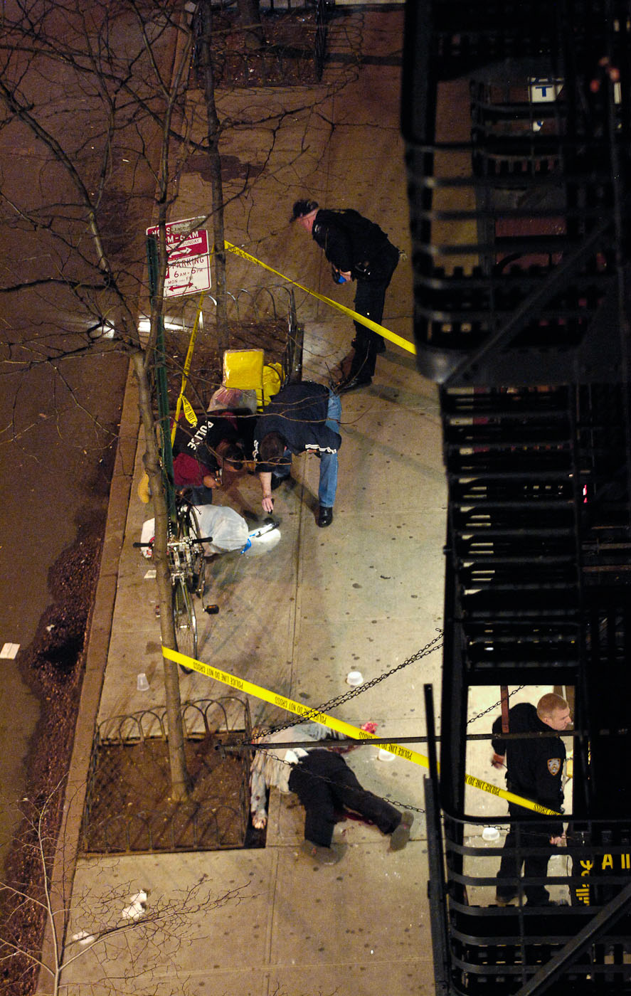 David Garvin lies dead on the sidewalk where he was killed after firing on six plainclothes police officers in New York, NY. Garvin killed a bartender and two auxiliary police officers.