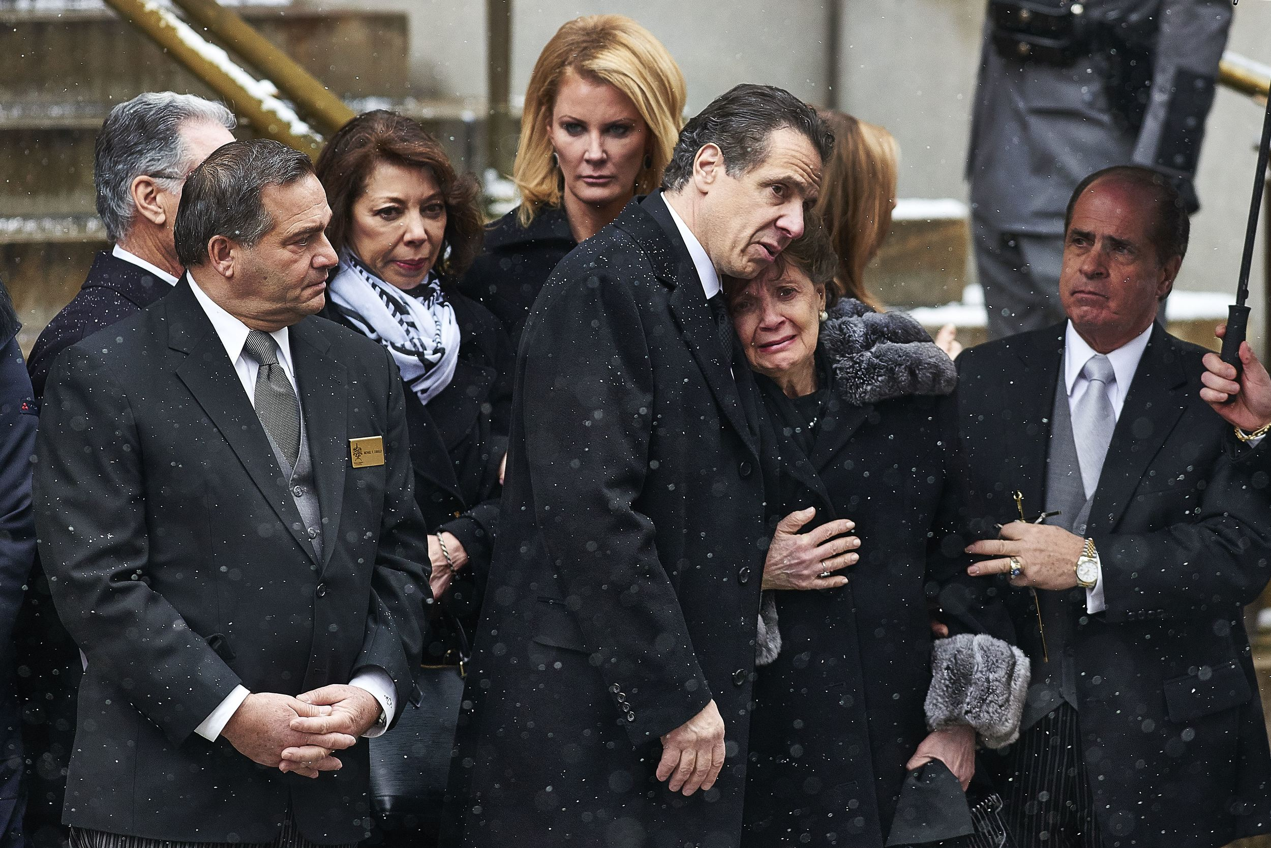 New York Governor Andrew Cuomo comforts his mother, Matilda Cuomo, as pallbearers carry the casket of her husband, former New York governor Mario Cuomo, out of the Church of St. Ignatius Loyola during his funeral on Tuesday, Jan. 6, 2015 in New York, N.Y.