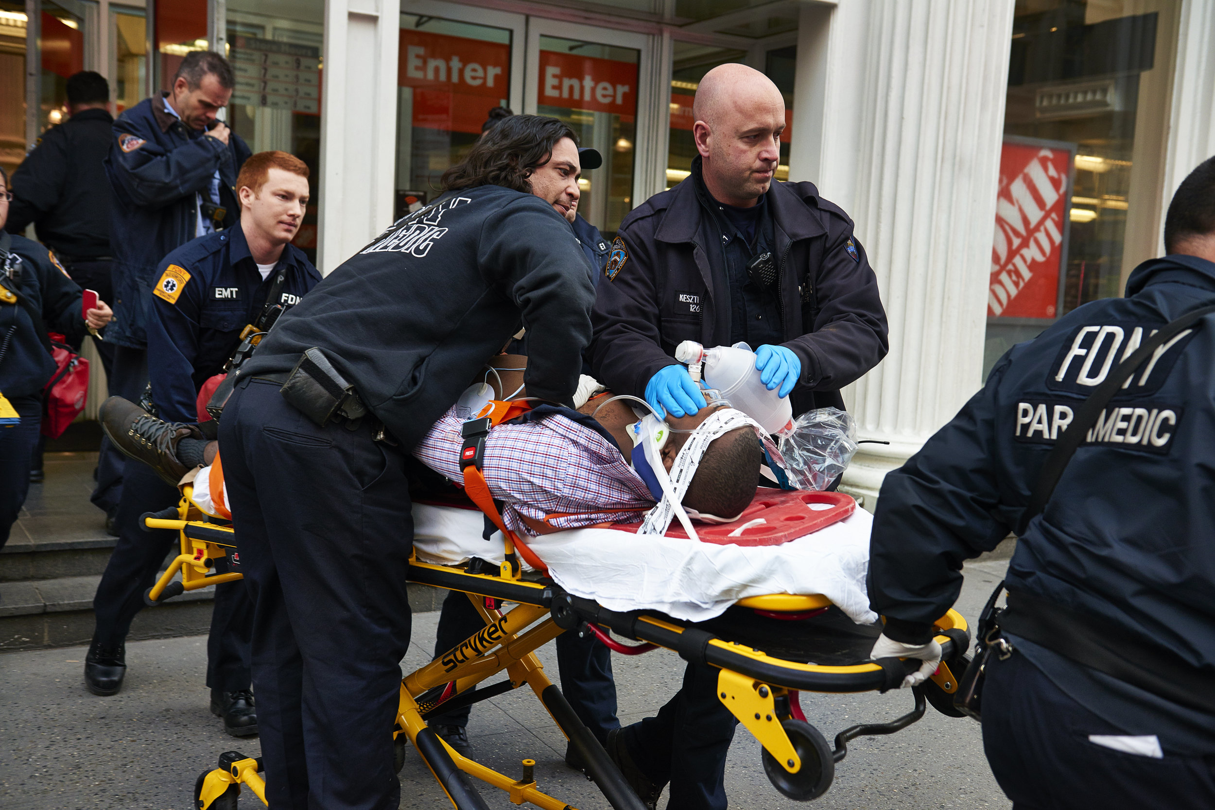 A shooting victim is transported to the hospital after one person was shot dead at a fatal shooting at a Home Depot store in midtown Manhattan on Sunday, January 25, 2015 in New York, N.Y.