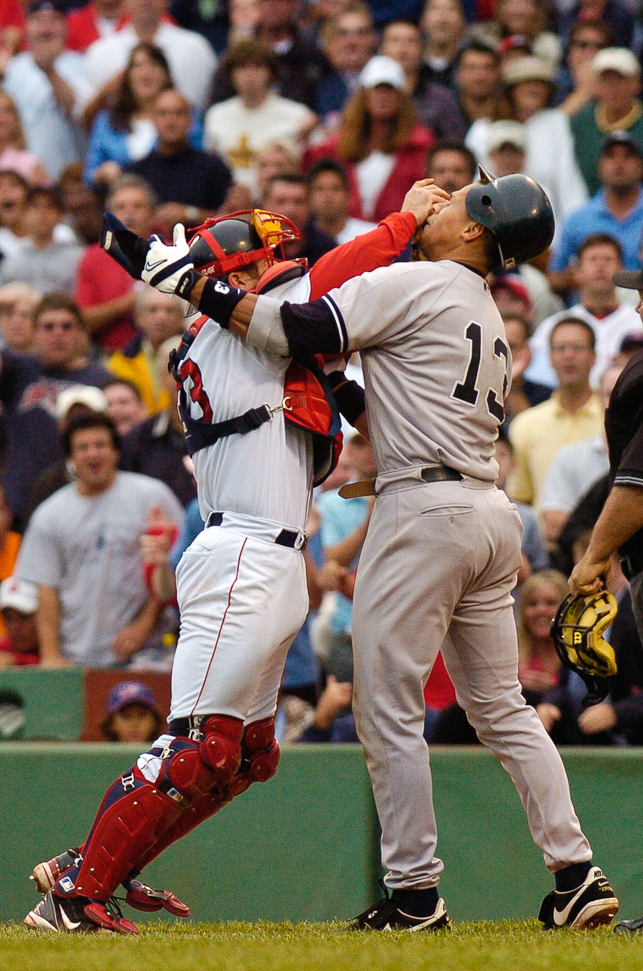 New York Yankees' Alex Rodriguez and Boston Red Sox catcher Jason Varitek fight during a game in Fenway Park on July 24, 2004 in Boston, Mass.