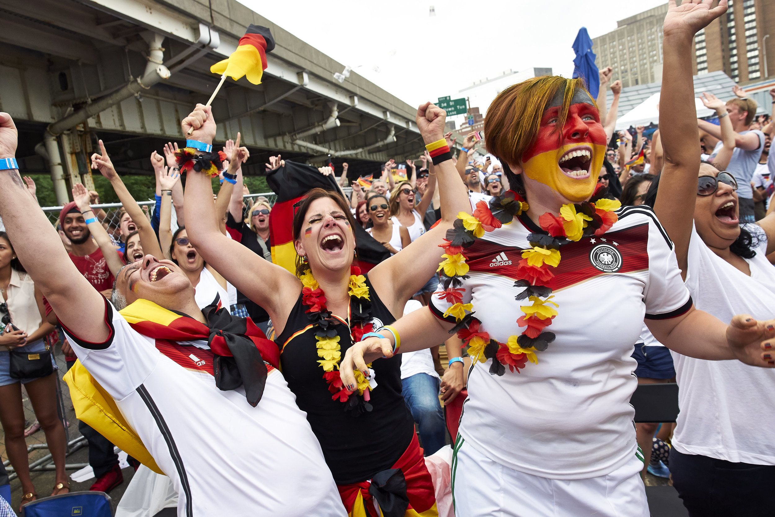 German fans celebrate their 1-0 victory over Argentina in the 2014 FIFA World Cup final between Germany during an outdoor viewing near the East River on Sunday, July 13, 2014 in New York, N.Y.