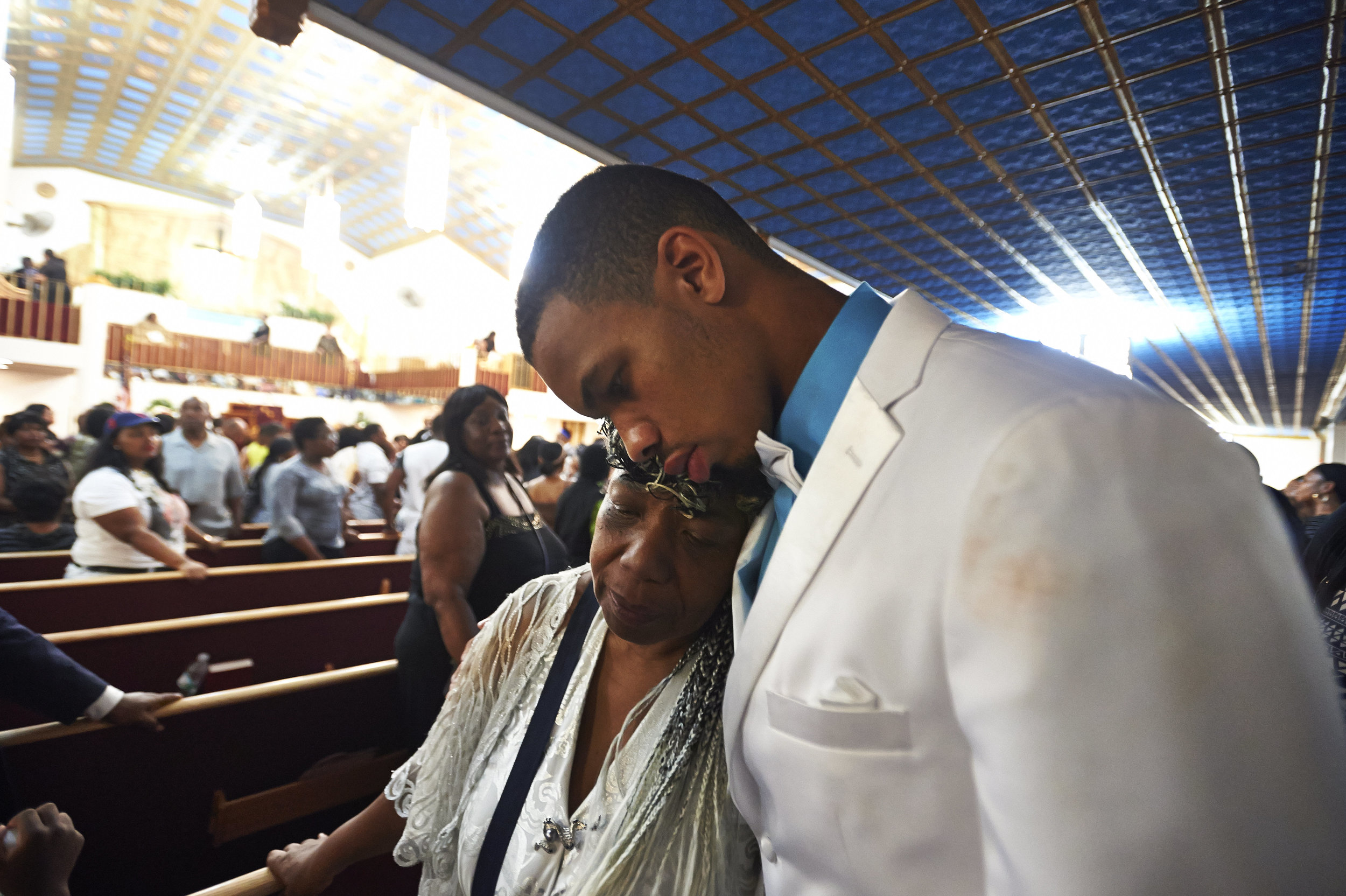 Gwendolyn Flagg-Carr, mother of Eric Garner, and Eric Snipes Garner, Jr., son of Eric Garner, leave his funeral service at Bethel Baptist Church on Wednesday, July 23, 2014, in New York, NY.