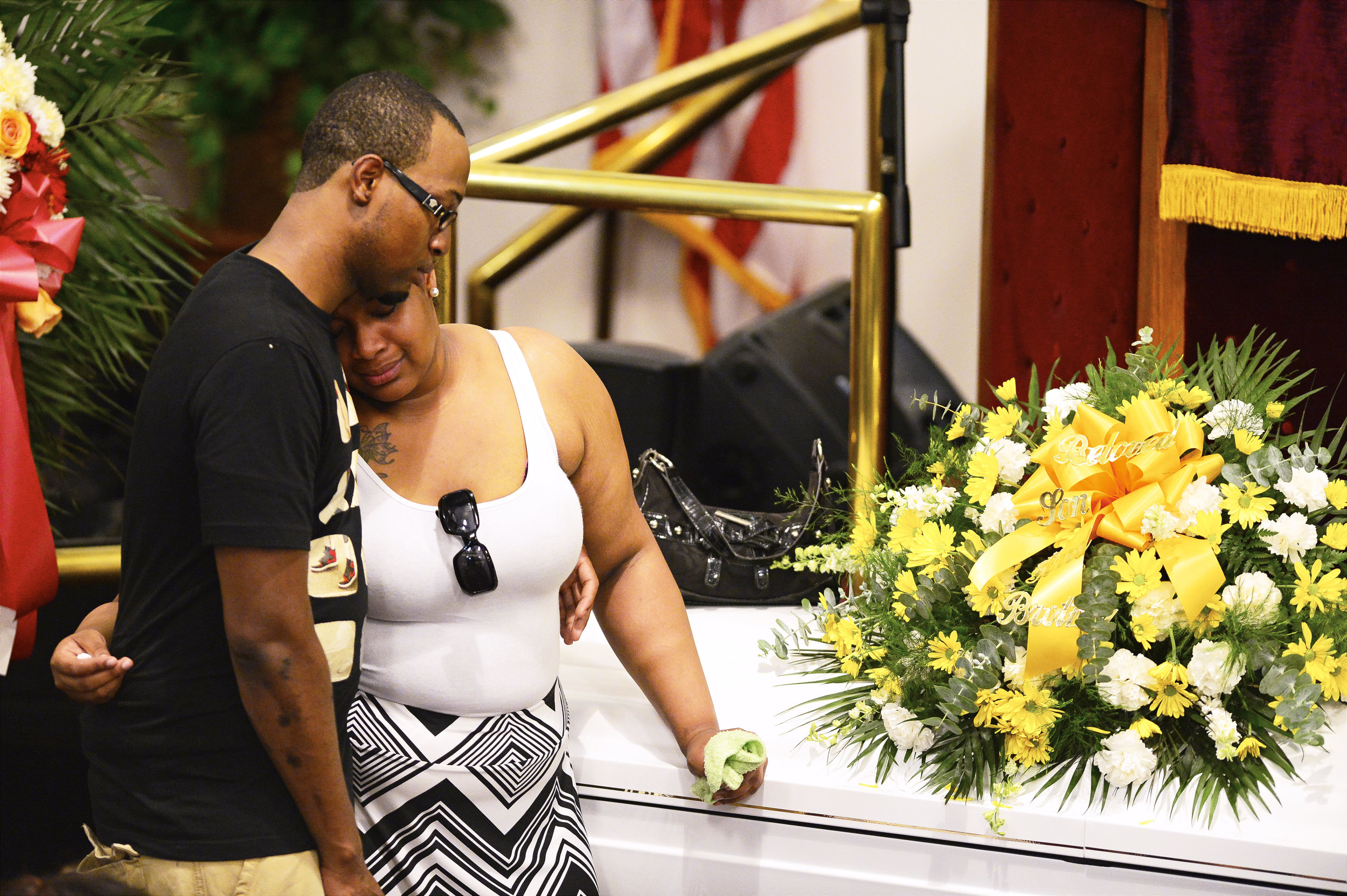 Emerald Garner stands next to the coffin of her father, Eric Garner, during his funeral at Bethel Baptist Church on Wednesday, July 23, 2014, in the Brooklyn borough of New York City.