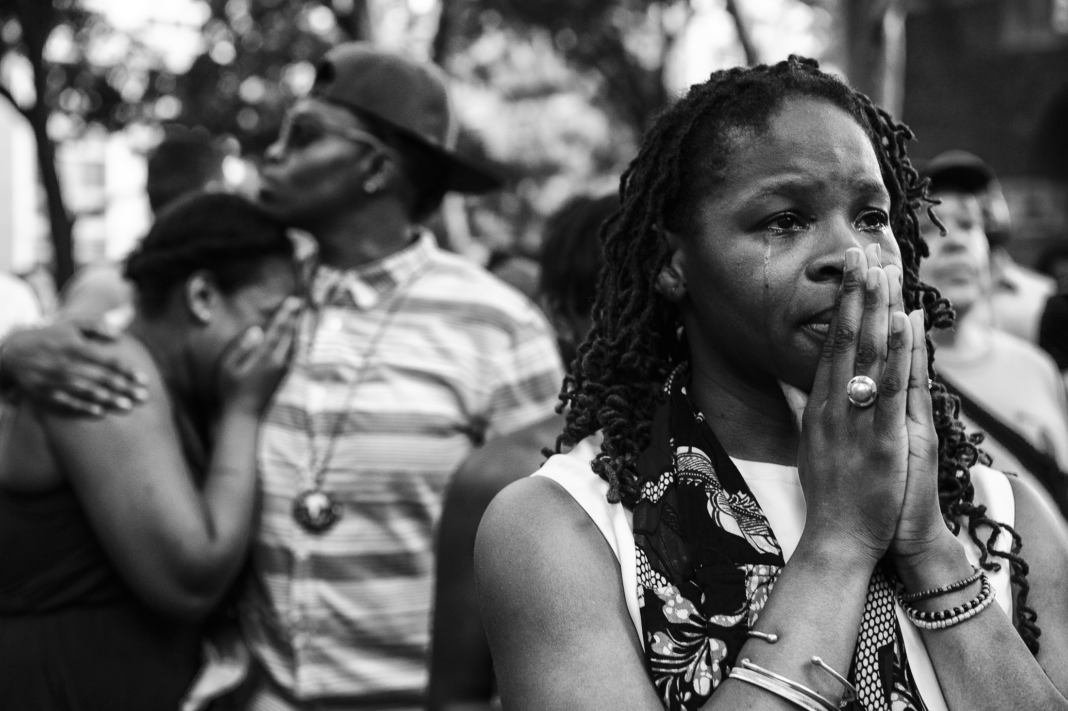 People mourn at a vigil for Islan Nettles at Jackie Robinson Park on Tuesday, Aug. 27, 2013 in New York, N.Y. Nettles was a transgender woman who was allegedly killed by Paris Wilson.