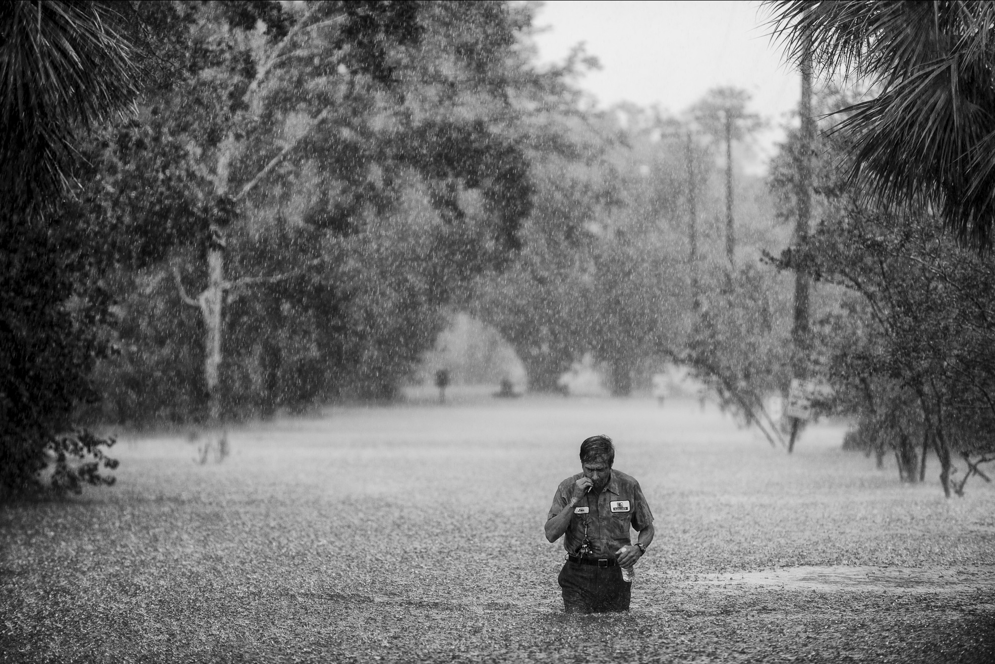 A resident crosses a flooded street in Slidell, La., on August 30, 2012, after Hurricane Isaac touched down in Louisiana.