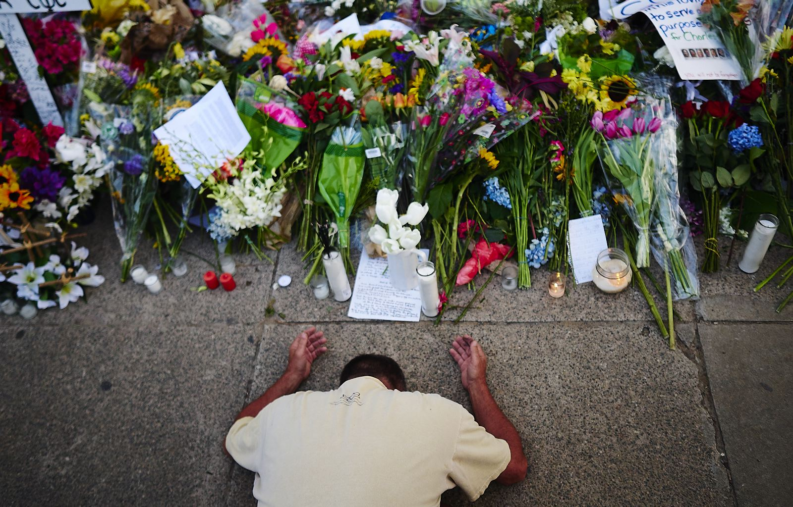 Raymond Smith, of Erie, PA, prays before the start of Sunday prayer services at the Mother Emanuel AME Church on Sunday, June 21, 2015 in Charleston, S.C. The church, closed since Dylann Storm Roof killed nine parishioners during a prayer meeting last week, reopened for Sunday services.