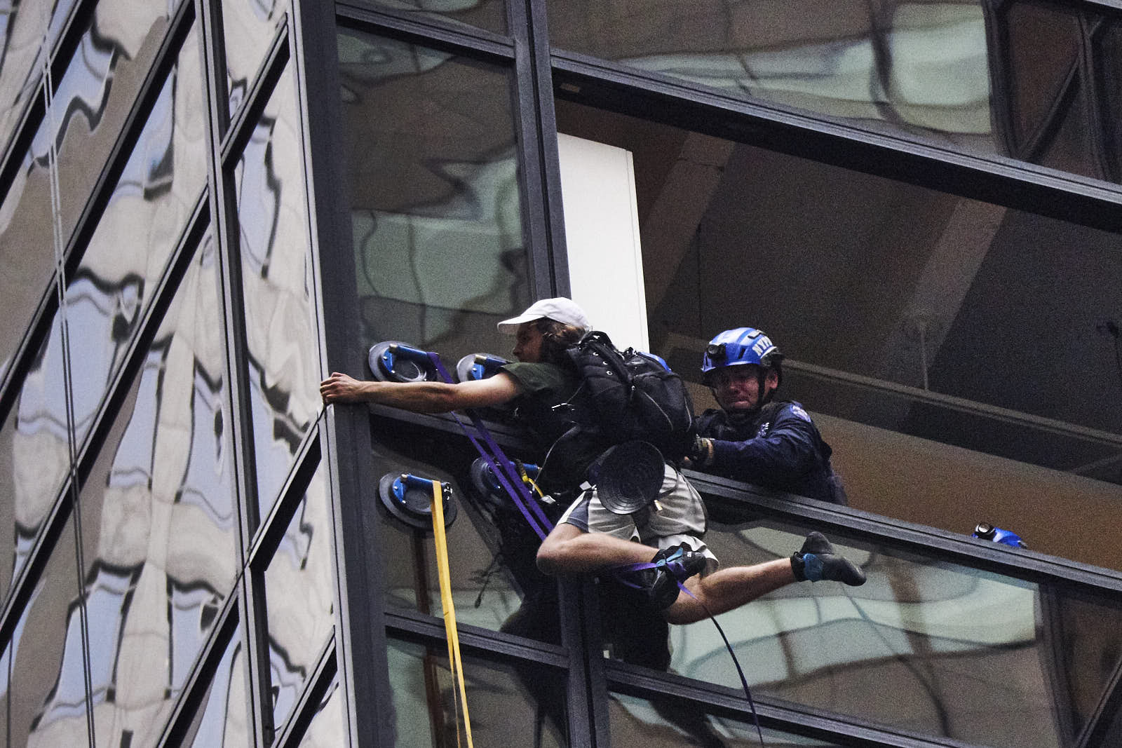 New York Police Department officers apprehend Stephen Rogata after he scaled Trump Tower with suction cups on Wednesday, August 10, 2016 in New York.