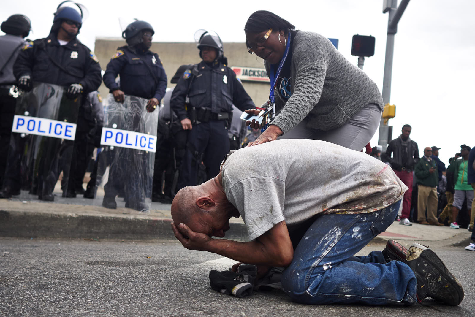 A woman consoles a grieving protestor as demonstrations continued after the funeral of Freddie Gray on on Friday, May 1, 2015 in Baltimore, M.D.