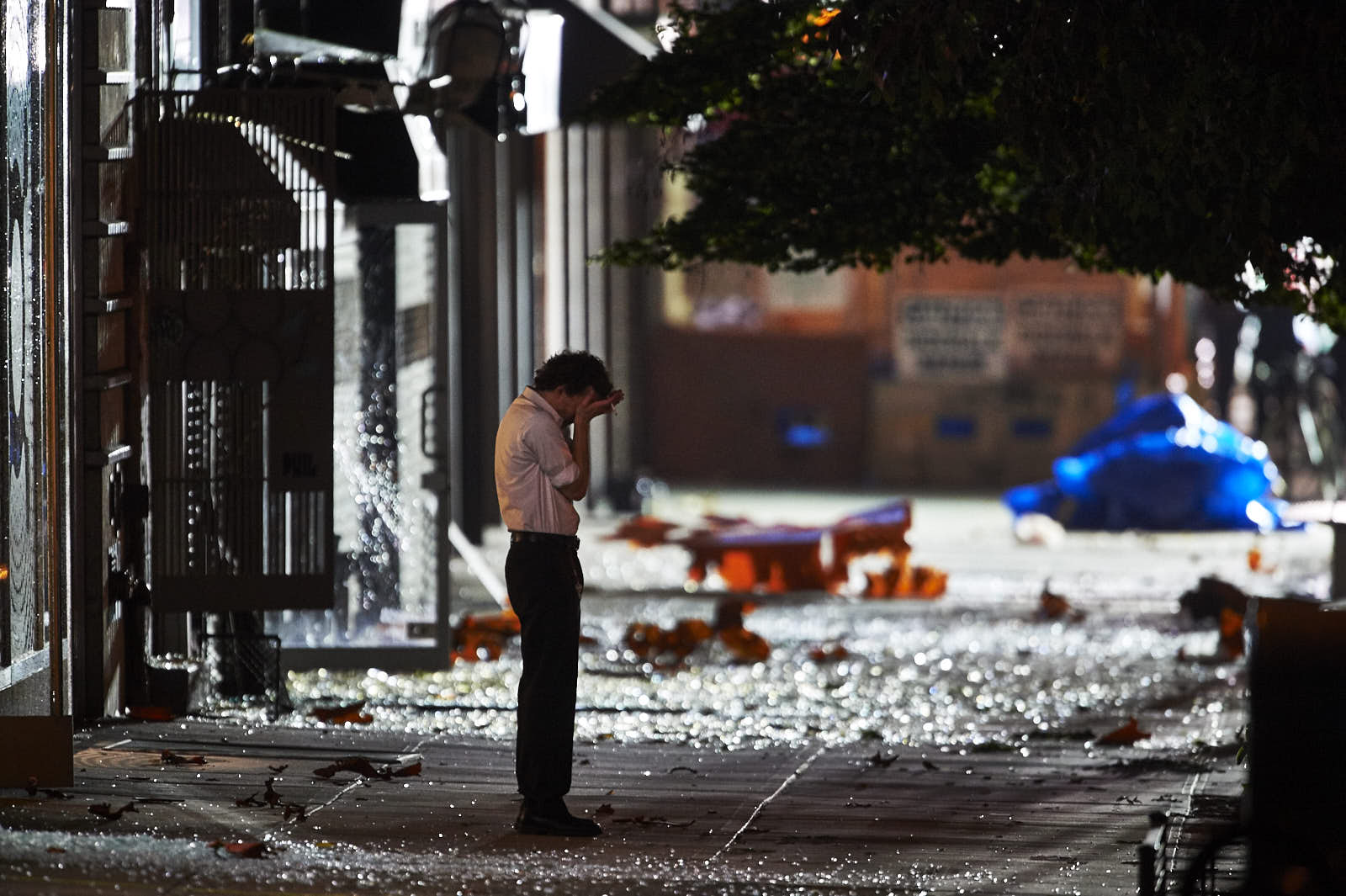 A man is surrounded by debris from Saturday's bomb blast on Monday, September 19, 2016 in New York. An all-out search was launched by the NYPD and federal law enforcement for the terrorists who set off a bomb on a crowded Manhattan street — and planned to detonate a second one four blocks away. Twenty-nine people were injured in the explosions.