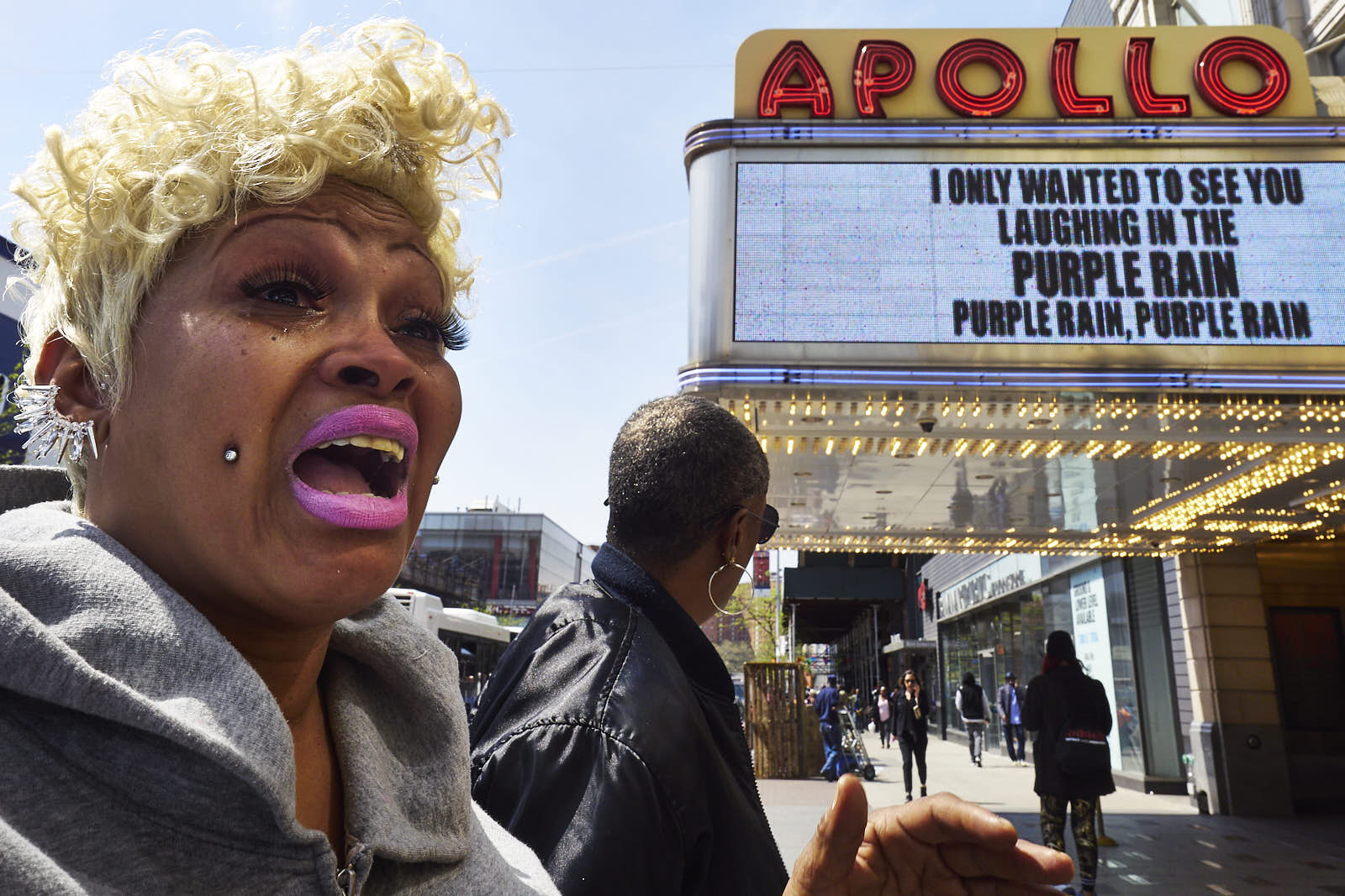 Caren Menardy, of Harlem, NY cries outside the Apollo Theatre after hearing about the death of musician Prince on Thursday, April 21, 2016 in New York, N.Y. Prince, the multi-talented musical genius who emerged from Minneapolis with a unparalleled funk-rock sound that made him a global megastar, died suddenly at his home.