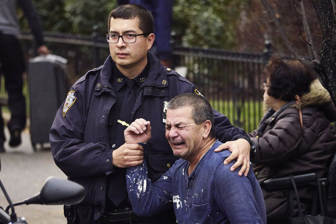The father of a man who died after falling from a building at 62-98 Saunders St. cries out in grief in Queens.  John Davie, 26, was renovating the window when he tumbled out the top-floor apartment.