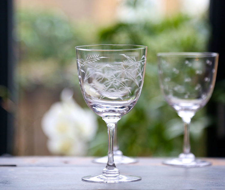 WINE GLASSES   A traditional bowl shape, with long, fine stem, it can be used for red or white wine. 16.5 cm tall; 8.5 cm wide; capacity: 250 ml