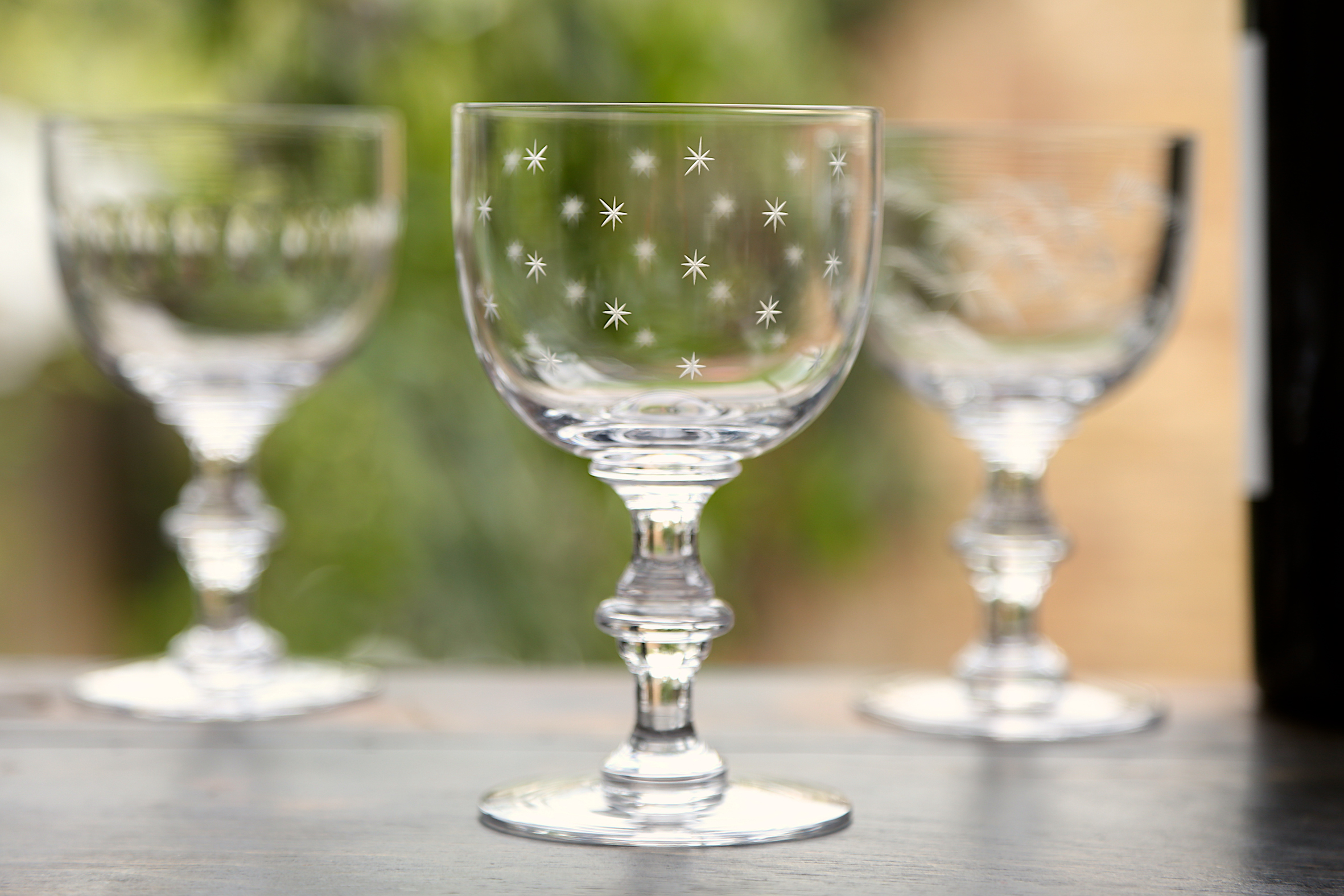 WINE GOBLETS   This glass has a sturdy, baluster stem and a much more delicate bowl. 14.c cm tall; 8.5 cm wide at rim; capacity: 250 ml