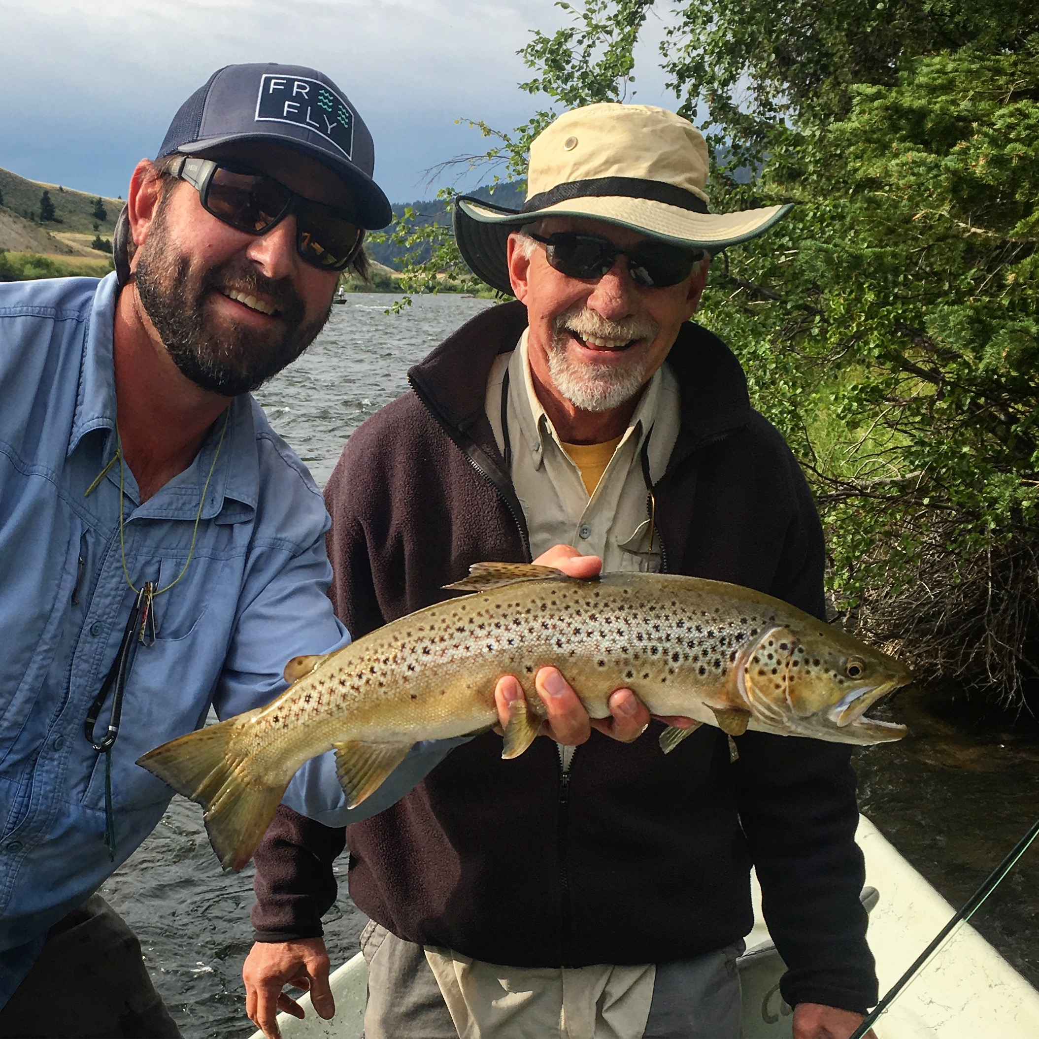 "Rocky with a 21"" Madison River Brown Trout on a dry fly"