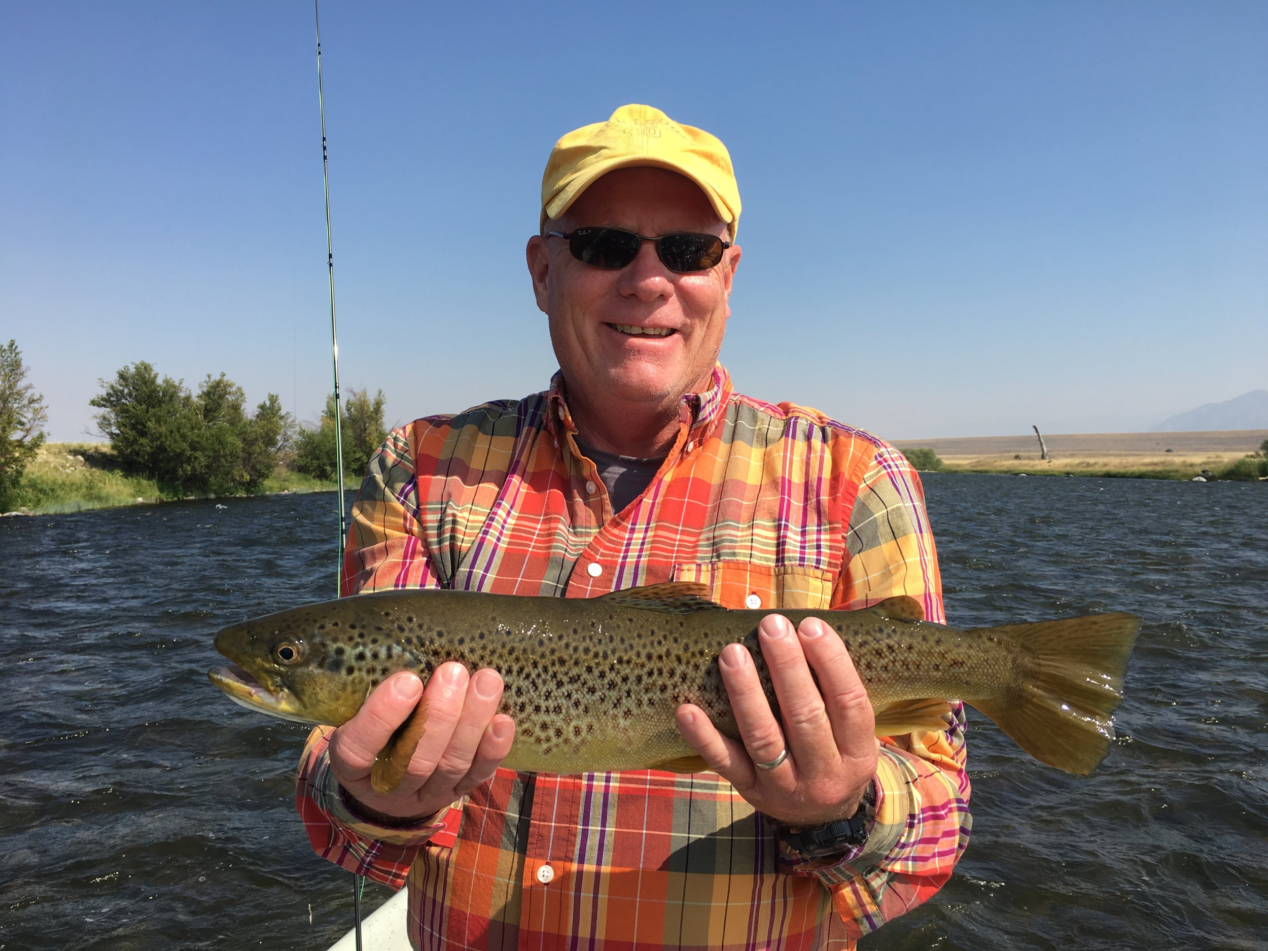 Randy with an early morning Brown Trout caught on a streamer