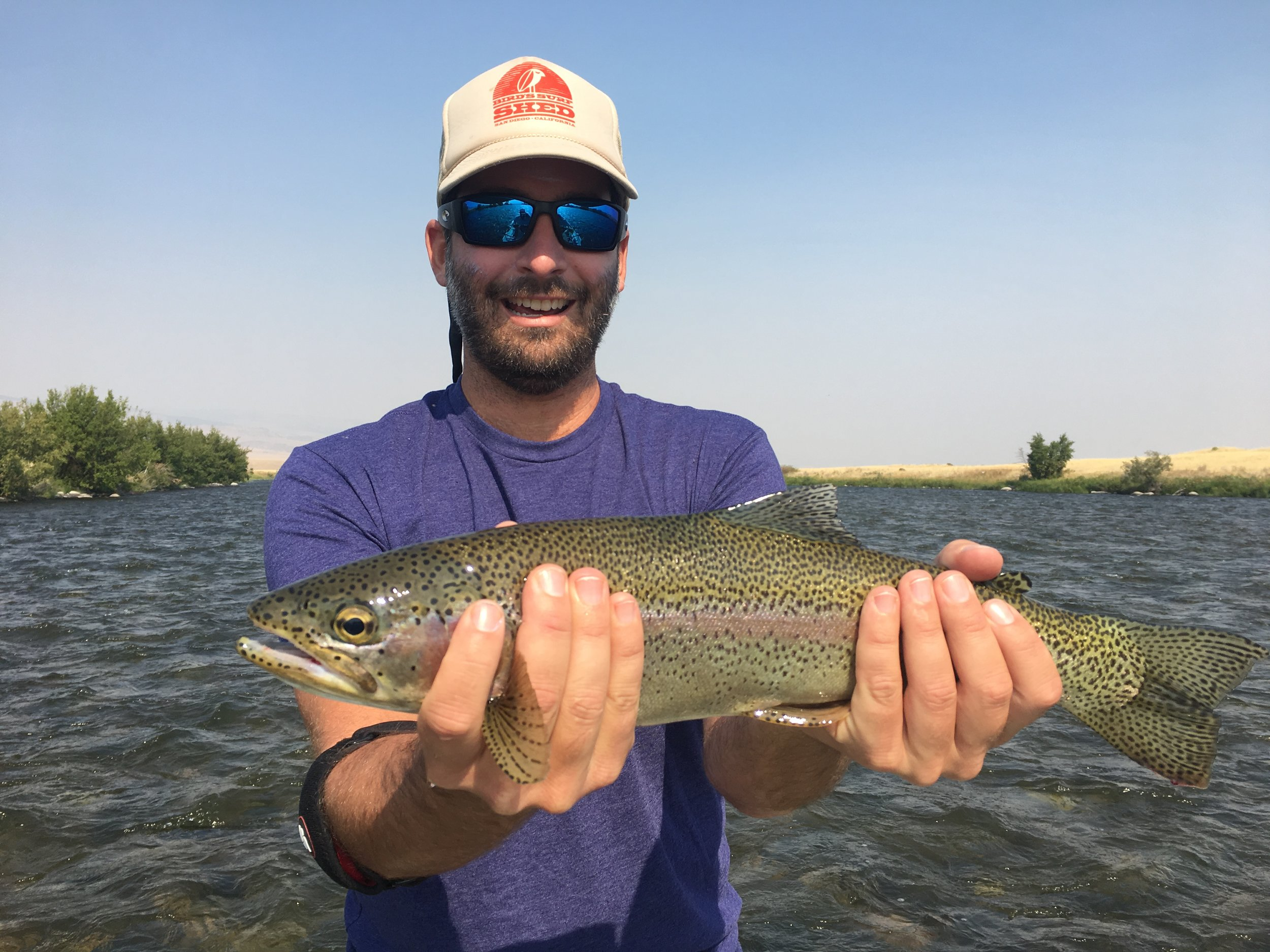 Brent from Charleston, SC with a great Rainbow Trout caught on a pearl zonker