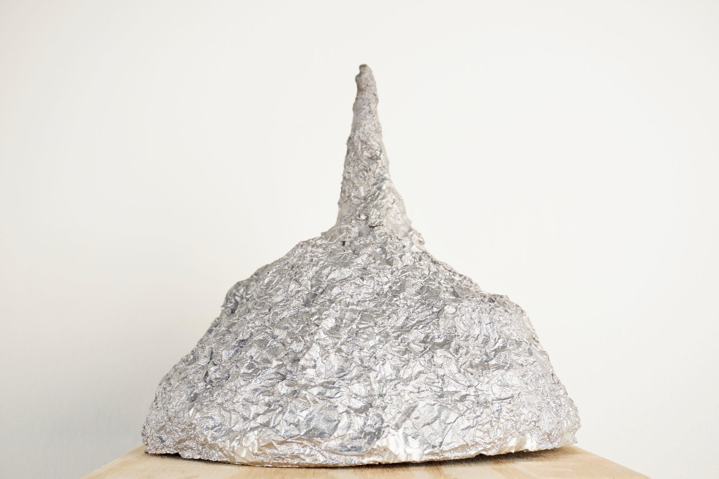 tin foil hat aluminum cast conspiracy theory art sculpture lukas liese.jpg