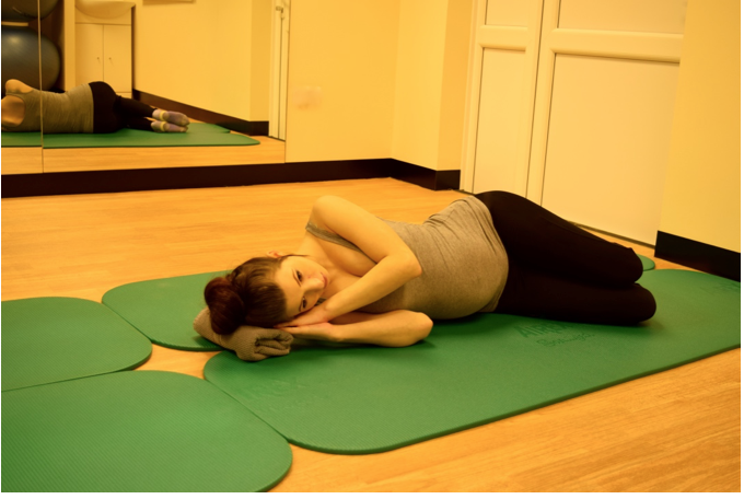 Place a pillow under your head to support your head and neck. You can lay with your back to the wall so make sure your shoulders, hips and feet are touching the wall and are inline.