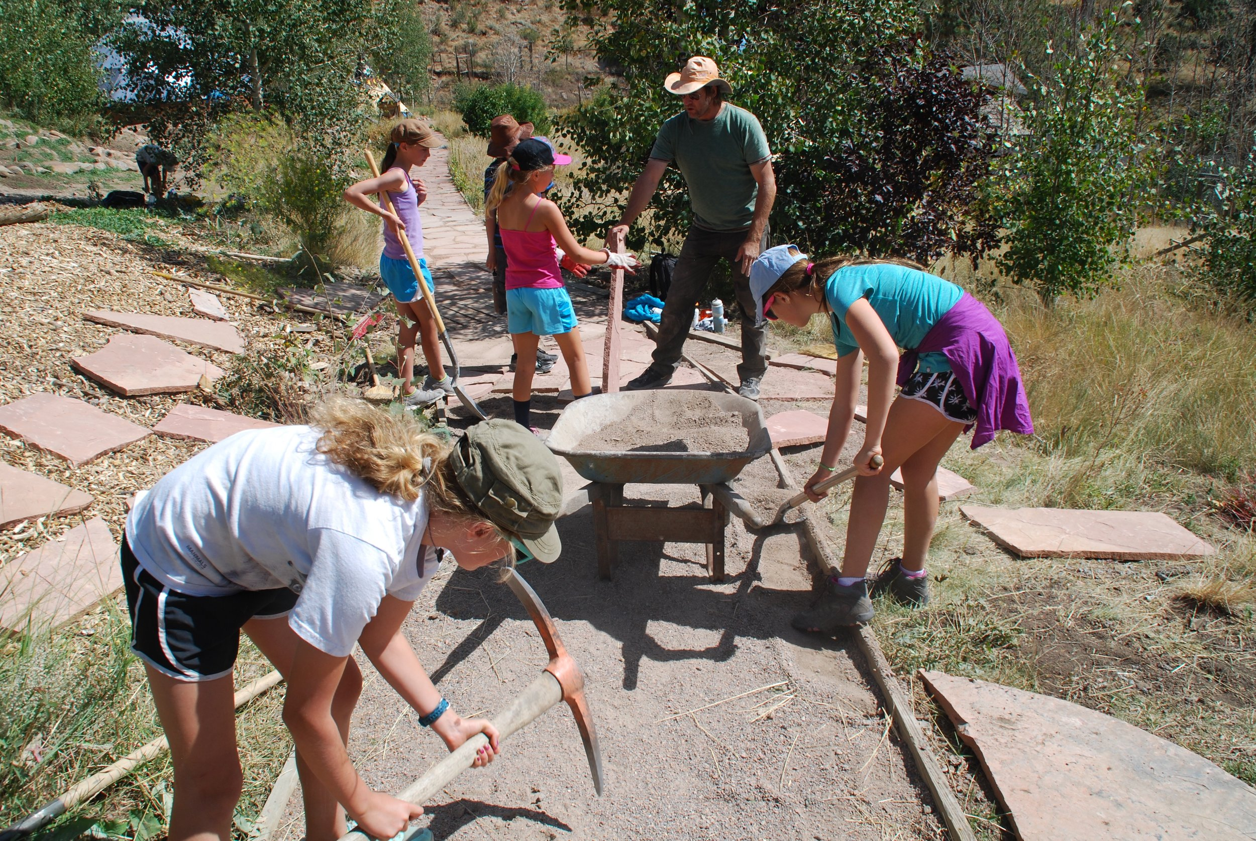 Building a flagstone walk at Mission:Wolf.
