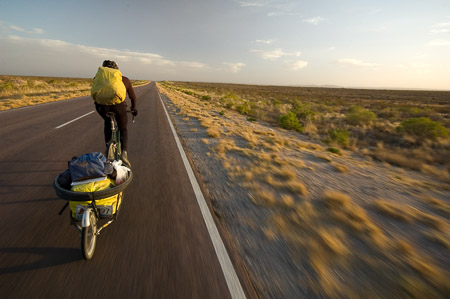 John Logsdon pedaling through the open vistas of the Patagonia Steppe, one of the world's largest deserts.