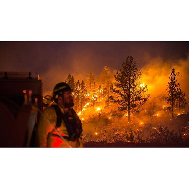 """Britania Mountain Fire / 08.31.2018 // Firing operations continued through the night as the fire was expected to reach our containment line under its own will that day. A separate night ops division came in to take over but not until we pushed into the dark on a 16+ hr shift. (The crews doing the firing had an even longer day). Fortunately temps and winds went down as humidity went up and we were able to watch the burn show progress smoothly into the dark. // 1: Engine boss Garret Wickre watches the hillside light up with hoses ready for spotting and to knock down heat along if needed along the fires edge / 2: Catching up to support the firing operations by Pike IHC along our containment line using Palmer Canyon Rd. On the right is """"black"""" burnt ground working into the fire, on the left is """"green"""" - unburnt fuels that we worked to keep unburnt. / 3: A ponderosa pine torching in the night / 4: Watching the burn show progress, ready to intervene"""