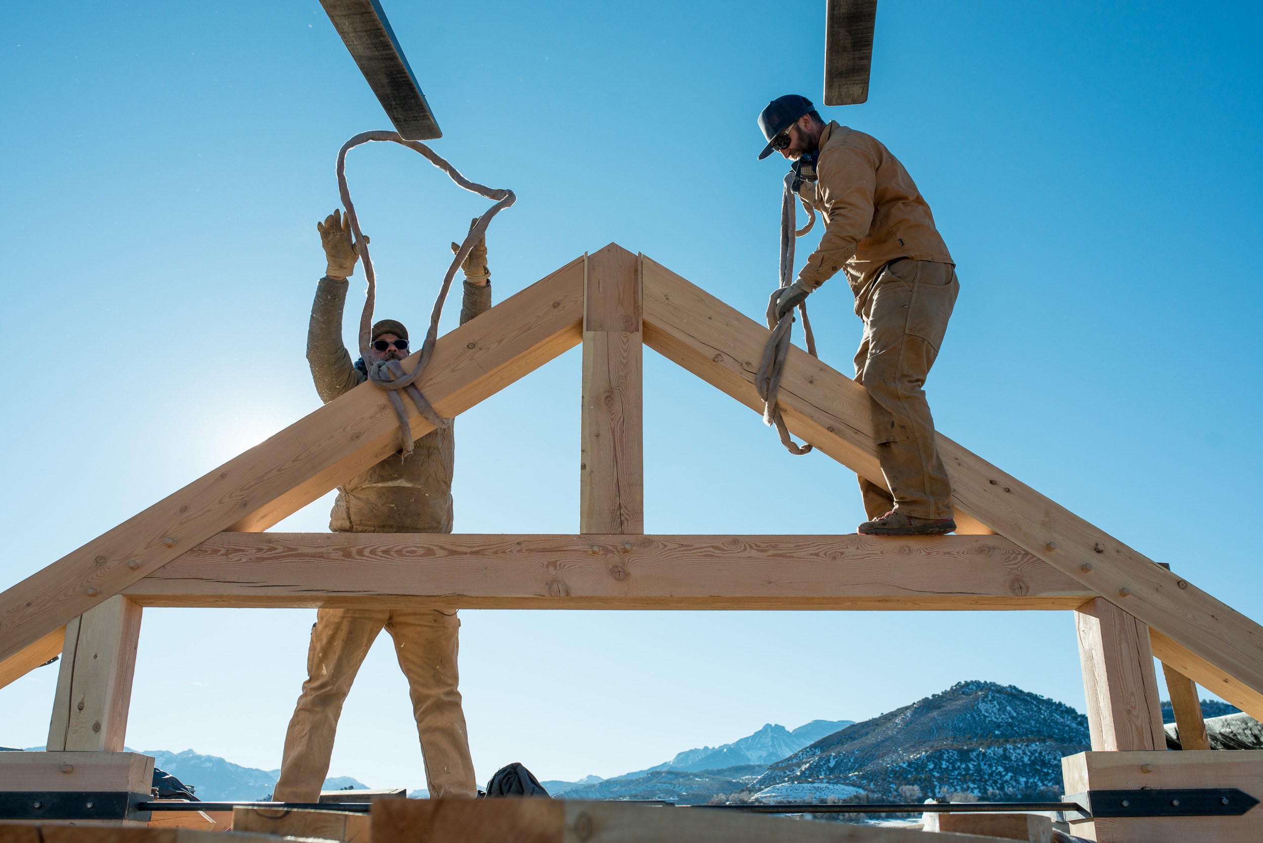 Phil and Bodie harness up a completed truss for relocation to staging