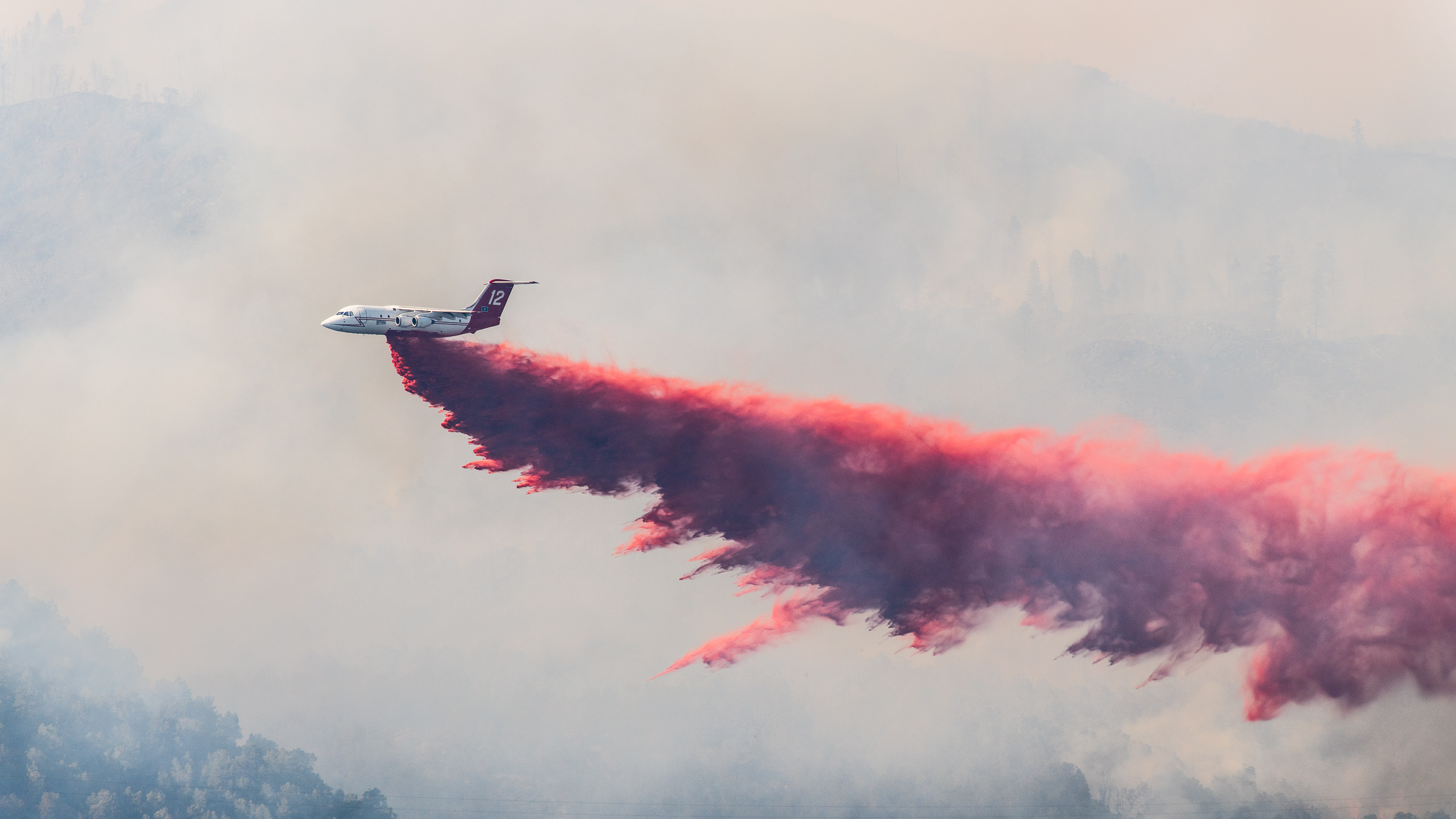 An air tanker drops a load of slurry at the edge of Basalt, CO on the Lake Christine fire on July 4th, 2018.