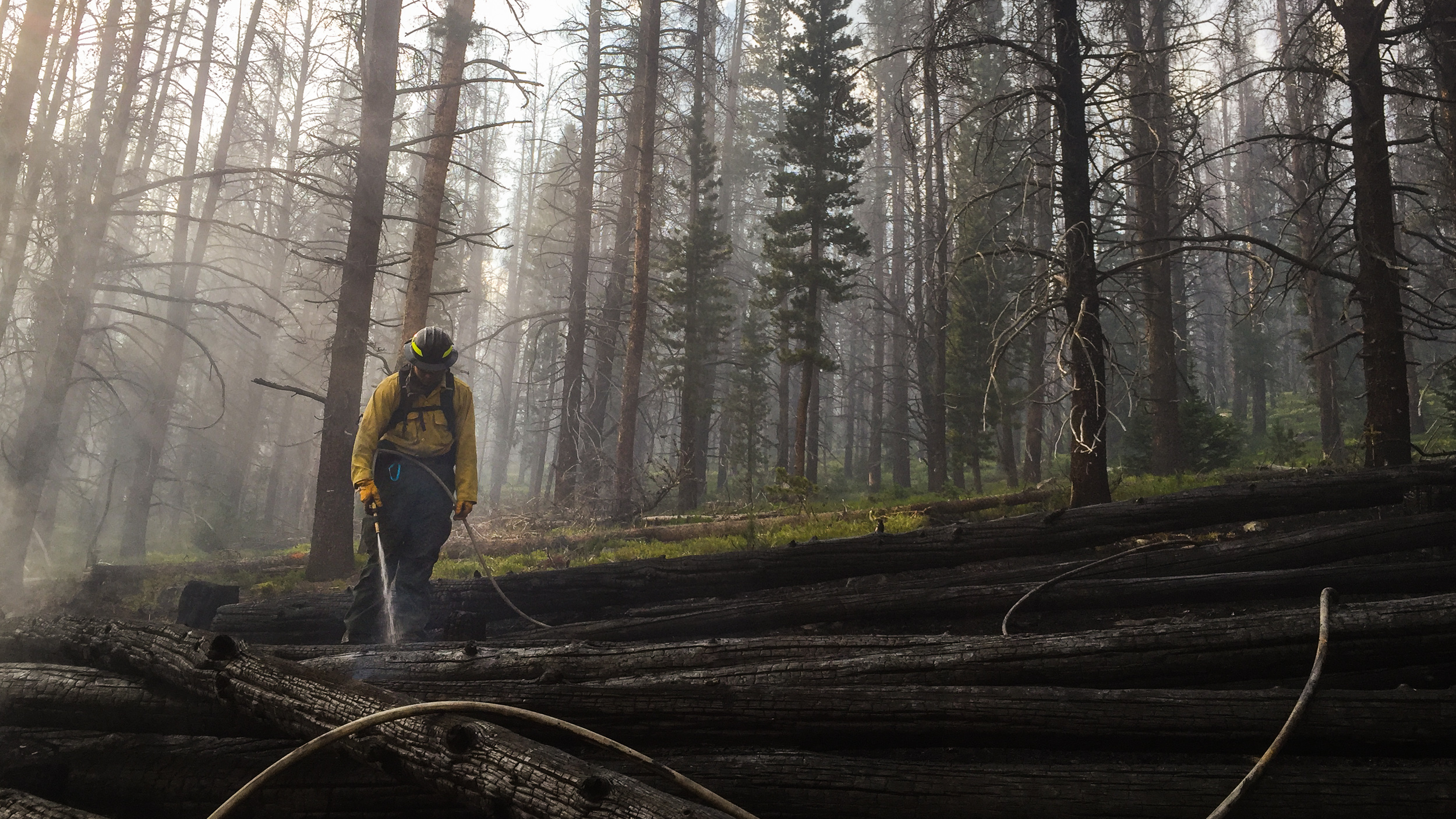 Johnny Tulare mops up embers on the Keystone Fire in southern Wyoming on July 4th, 2017.
