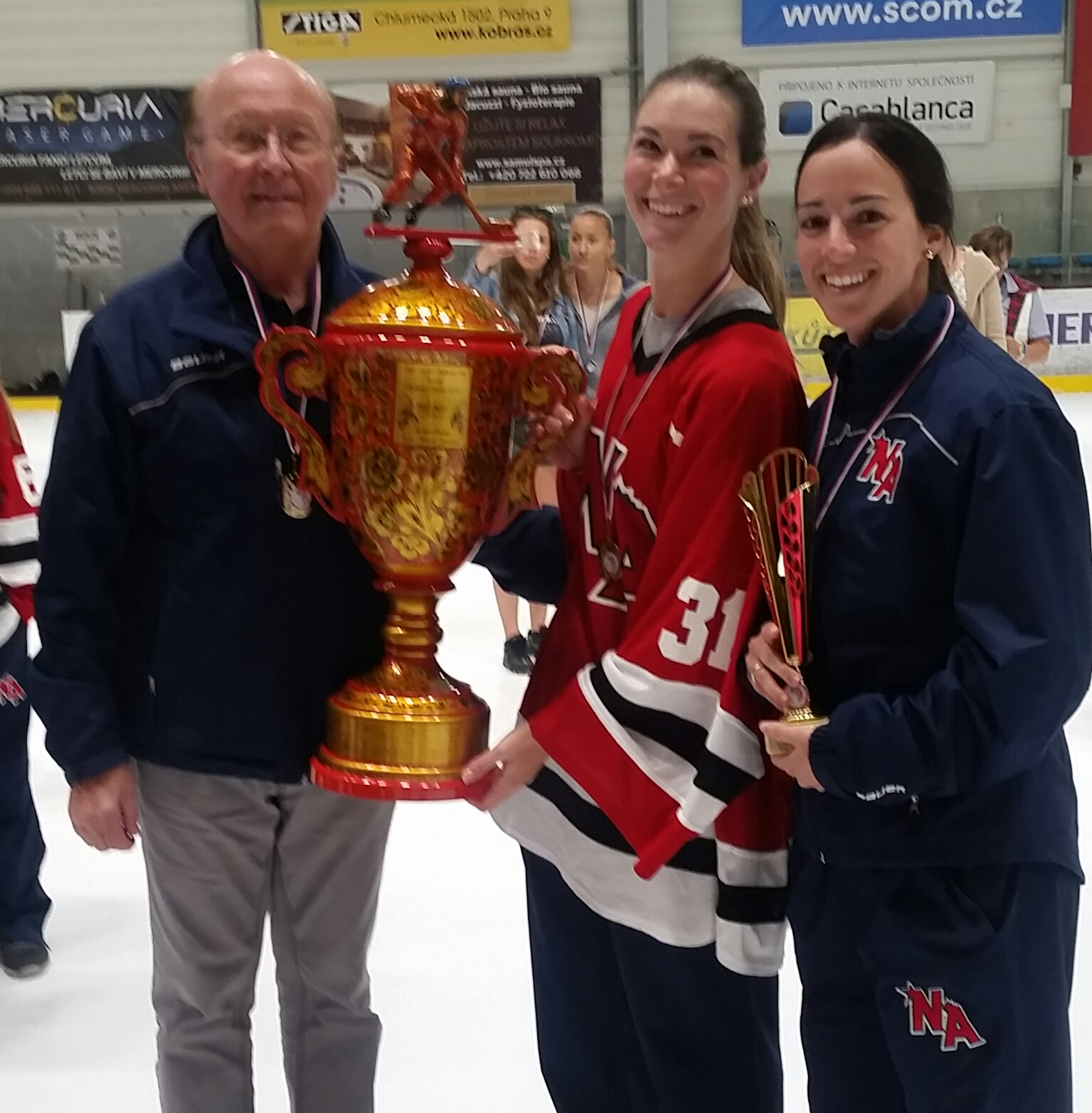 Team Captain Keira Goin with Coach Stephanie Scarpato and bob O'COnNELL after Team Red won gold at the chcc!