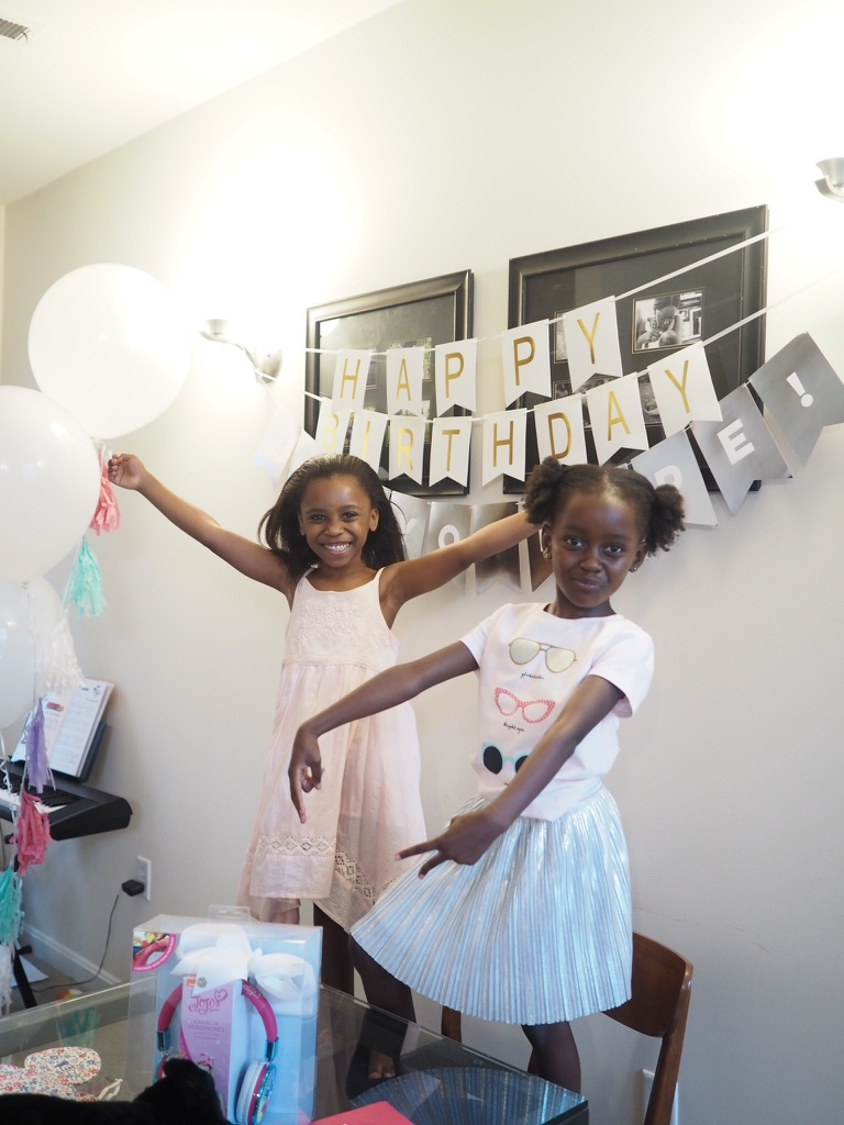 birthday morning - they showered and dressed and opened the first batch of gifts!