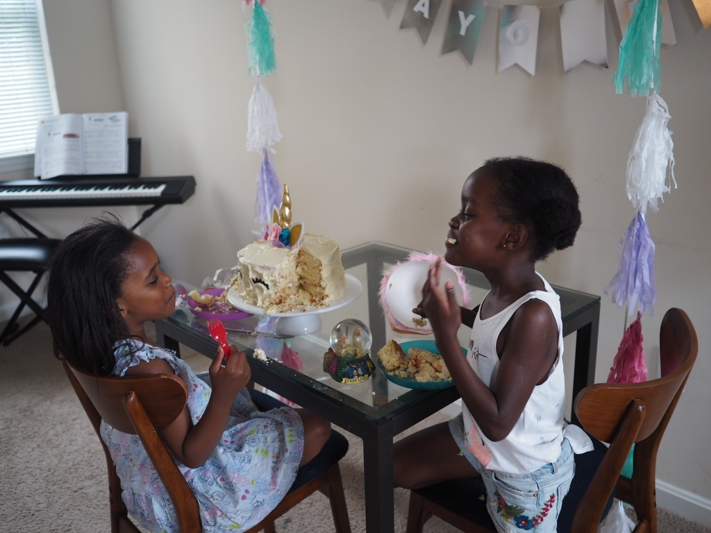 we served cupcakes at the party to make things simpler. as soon as we got home, these 2 changed and had a little tea party of their own with the cake!