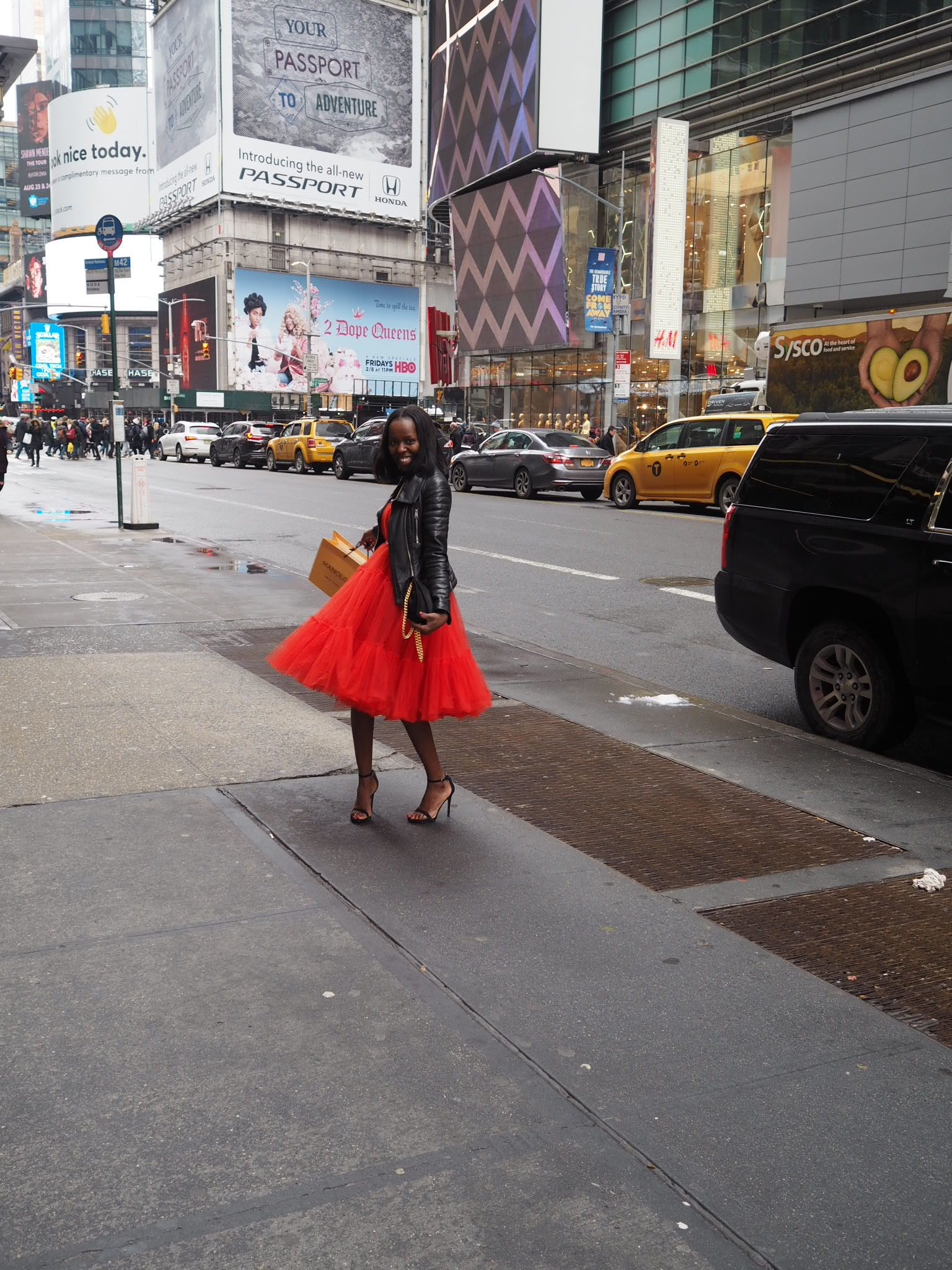 Lanvin H&M red dress & Allsaints Leather Jacket in New York City with Manolo Blahnik shopping bag
