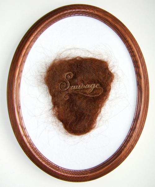 """Sauvage"", 2013, human hair embroidery on hair, velvet, 7 x 4"" piece, 12 x 9"" framed. Image via Kate Kretz"