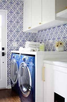 Laundry Room featuring bold wallpaper.