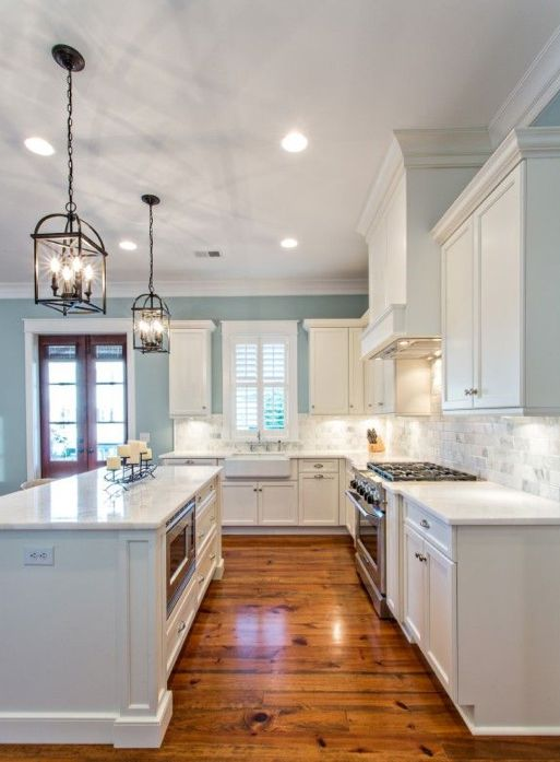 This Raindrop blue from Sherwin Williams compliments the white cabinets and adds a great bit of color to this gorgeous kitchen.  Photo courtesy of Pinterest