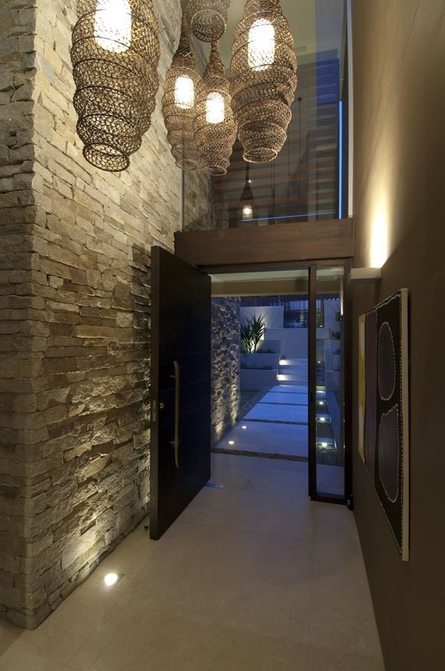 Up lighting makes this narrow space feel tall and expansive as well as accentuating the architectural features of the stone and entry fixtures – which are super awesome!