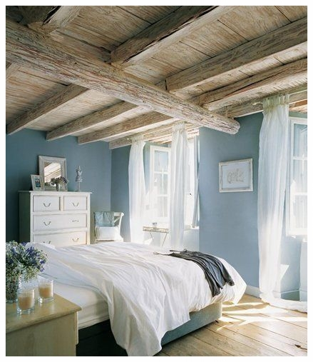 This peaceful bedroom features a cool blue mixed with crisp neutrals to create a calm space. Photo courtesy of Pinterest.