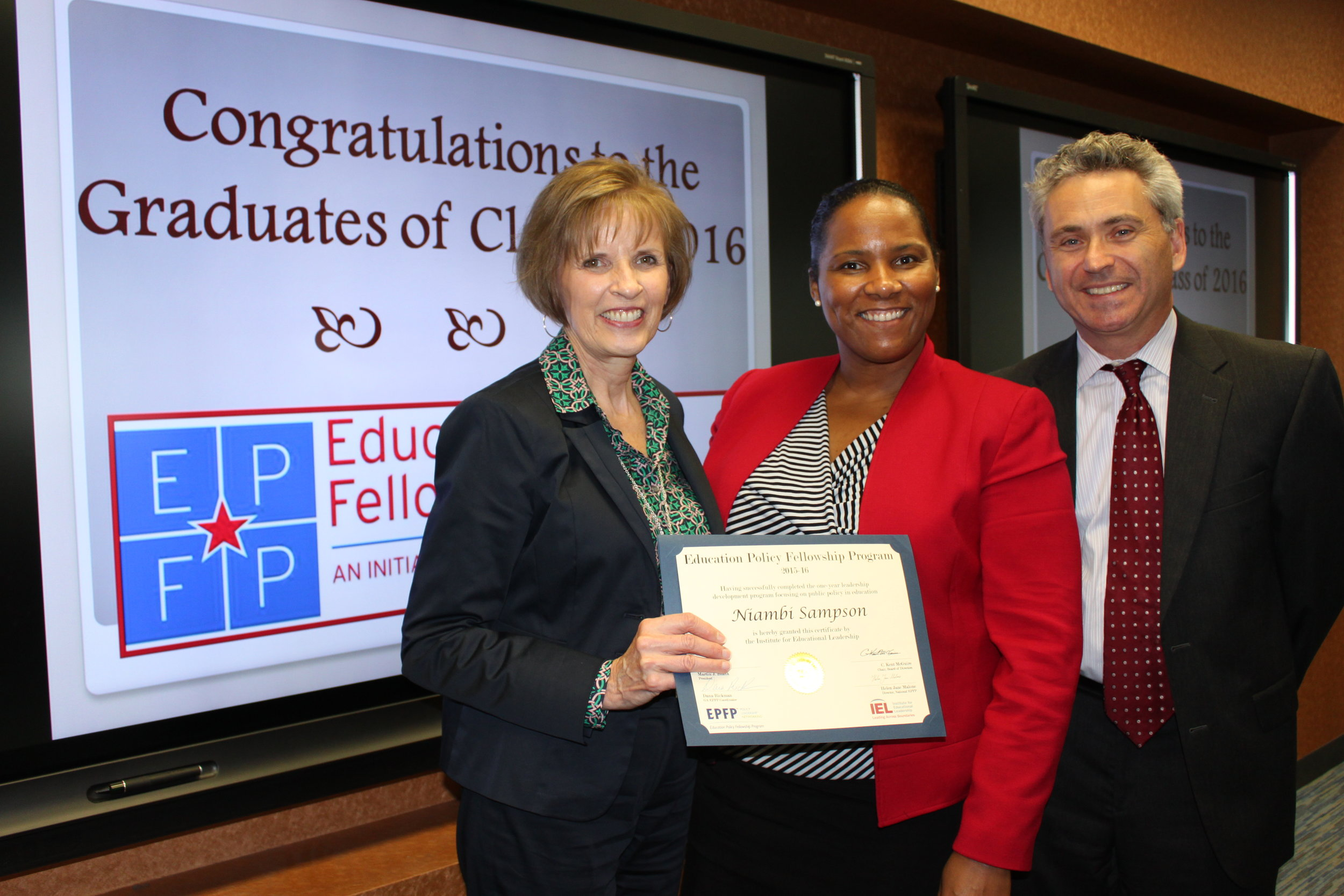 Sampson receiving her certification of participation in the EPFP