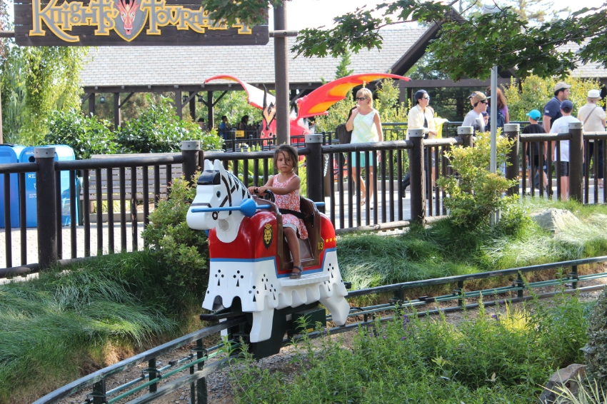 """Across from the medieval castle, youngsters can ride their very own LEGO®horse through an enchanted forest, complete with jousting LEGO knights. 36"""" Min height"""