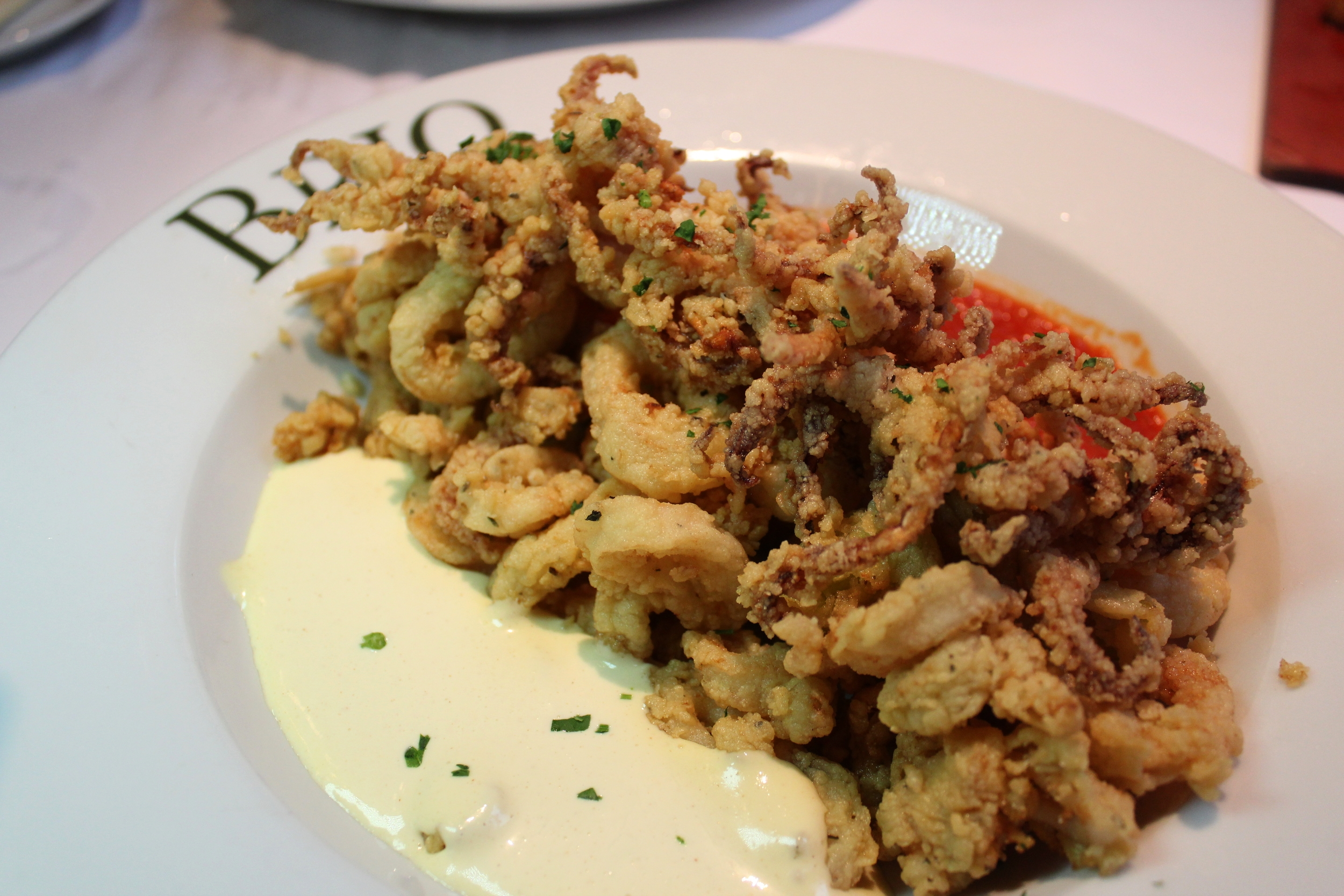 Calamari Fritto Misto Crispy golden brown calamari, peperoncinis served with a creamy aioli and a pomodoro sauce