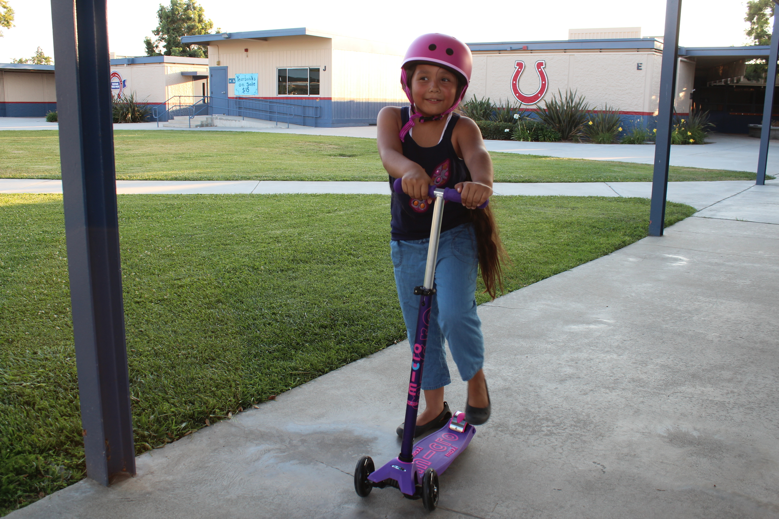 After school fun while building her confidence, love this! And she's all about safety with her matching helmet too.