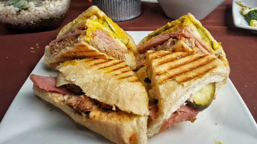Cubano Stefano  Golden Baked Ham, Carnitas, Swiss Cheese, Dill Pickle, Stefano Mayo, & Yellow Mustard.