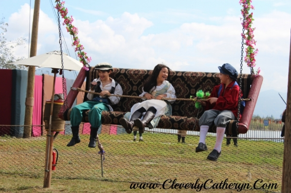Their smiles say it all! This swing is a big hit at the Faire.