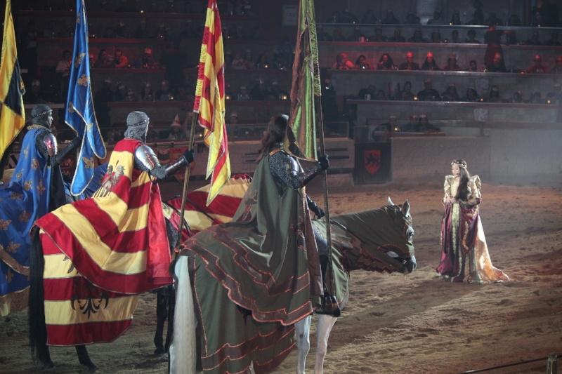 Addressing her knights, Queen Isabella commands respect as well as gives it.