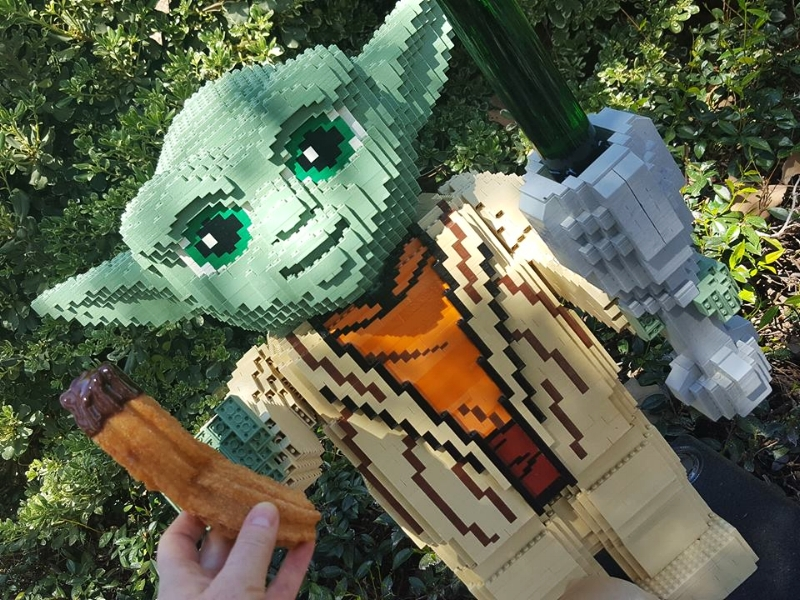 Yoda in Star Wars Miniland, head past him and to the left you will find the Churro Stand.