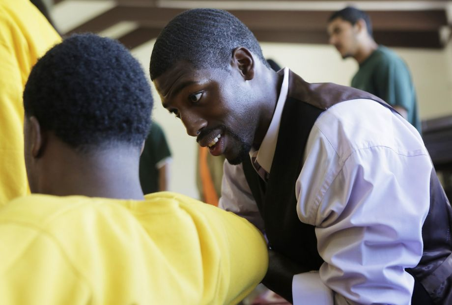 """Juvenile Justice Delinquency Prevention Commissioner Tony Robinson speaks to a young man of Camp Sweeney during the morning pep rally or """"Harambee"""" as a part of Freedom School, a summer program at Camp Sweeney Academic Center, in San Leandro, Ca. on Tuesday, Aug. 4, 2015.  Photo by Dorothy Edwards 