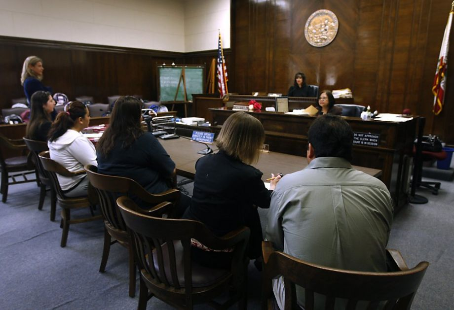 A family appears before Superior Court Judge Gloria Rhynes during a truancy court session at the Alameda County Courthouse in Oakland, Calif. on Friday, June 17, 2011.  Photo by Paul Chinn | San Francisco Chronicle